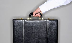 Hand holding briefcase