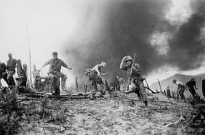 Horst Faas gallery: U.S. Marines scatter as a CH-46 helicopter burns
