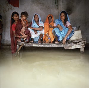 Drowning World: India - Floods - Group portrait with floodwaters