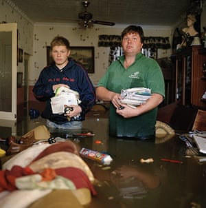 Drowning World: Doncaster, UK: Graham Leith and his son Kieran in the flooded house