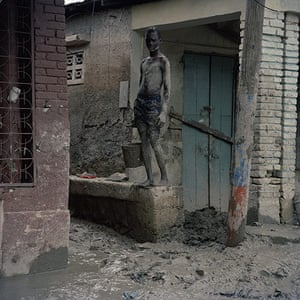Drowning World: Haiti - Climate Change - Removing mud after flooding