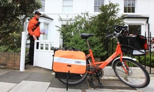 A TNT postal worker makes his rounds in Chiswick