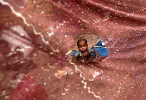 24 hours: New Delhi, India: A child from the Burmese Rohingya Community in a shelter