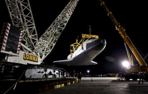 24 hours: New York, US: The space shuttle Enterprise hangs in the air at JFK airport