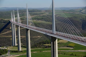 24 hours: Millau, France: Some of the 13,500 competitors cross the Millau bridge