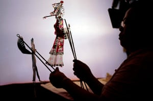 24 hours: Shanghai, China: An artist at a traditional shadow puppets