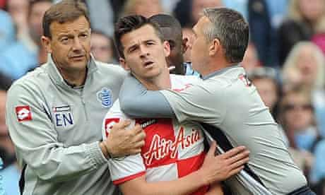 Joey Barton helped off field after red card