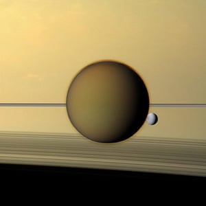 A month in space:  Titan's dense atmosphere shrouds the moon beneath a tan haze