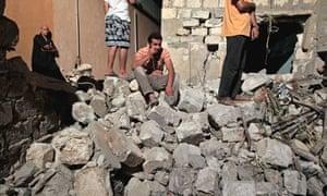 a damaged residential building in Tripoli, Libya