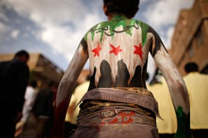 24 hours: Sana'a, Yemen: A youth painted with the colours of Syria's opposition