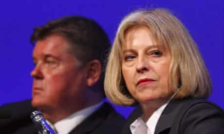 Theresa May and Paul McKeever at the Police Federation annual conference last year