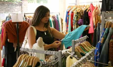 A woman shops in the British Red Cross charity shop off Kings Road in London
