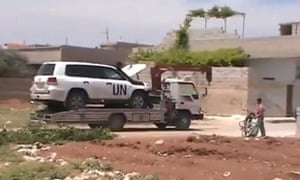 Video of UN monitors leaving Khan Sheikhoun in Syria with their damaged SUV on the back of a truck.