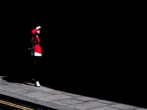 Your Pictures: Your Pictures: Girl wearing red, highlighted on black background by the sun