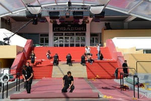 Cannes film festival: Workers prepare the red carpet in front of the Palais des Festivals