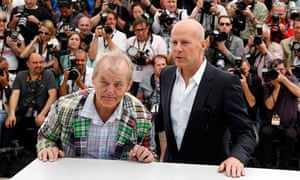 Cast members Willis and Murray pose during a photocall at the 65th Cannes Film Festival,