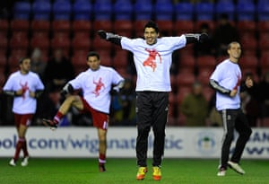 Kenny Dalglish: Liverpool's Suarez warms up with teammates