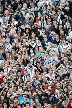 Moonrise: A crowd of spectators snap the celebraties on the red carpet