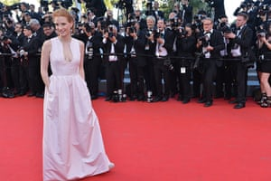 Moonrise: Jessica Chastain looks relaxed infront of a bank of photographers