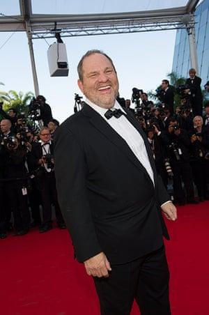 Moonrise: A jolly Harvey Weinstein jokes with photographers
