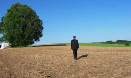 Business Man in field