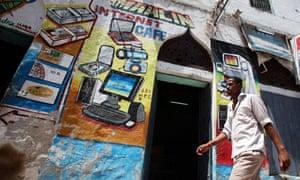 A man walks past an internet cafe in Mogadishu