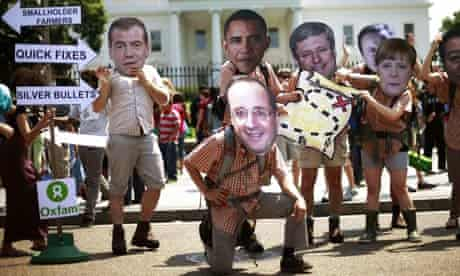 Oxfam activists pose in masks of the G8 leaders outside the White House