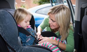 Child in car seat with mother