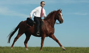 Young businessman riding a horse