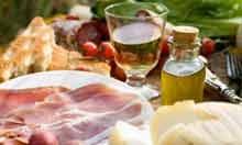 Prosciutto ham, cheese, tomatoes, white wine, bread and olive oil