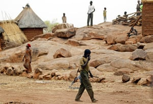 Nuba Mountains Conflict: A SPLA-N fighter walks in Jebel Kwo village, Nuba Mountains