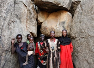 Nuba Mountains Conflict: Women stand in front of a cave in Bram village in the Nuba Mountains