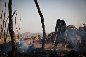 Nuba Mountains Conflict: A man in the remains of a house destroyed by Sudan Armed Forces in Tabanya