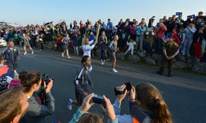 Olympic Torch Relay: Ben Ainslie handed the torch over to local surf champion Anastassia Swallow