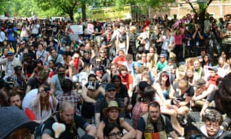 Protesters sit in the street in front of Rahm Emanuael's house in Chicago