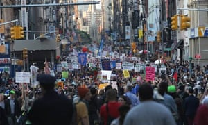 Demonstrators march down Broadway during a May Day protest in New York City.