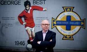 David Park in front of a mural of George Best in Belfast.