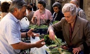 Italians shop in a food market