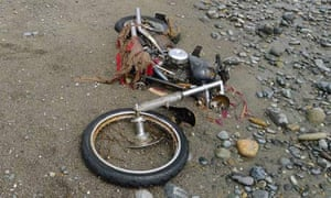 A motorbike swept away during the Japanese tsunami lies on a Canadian beach, 4,000 miles away.