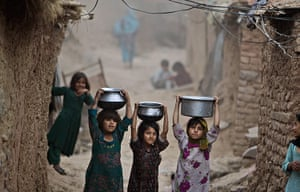 24 hours: Girls carry bowls of water on their heads in Islamabad