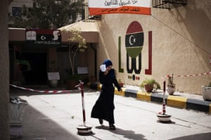 24 hours: A woman leaves a public school after registering to vote in Libya