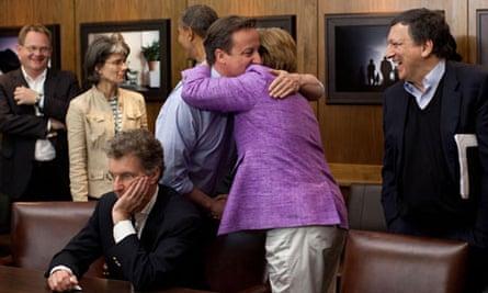 David Cameron hugs Angela Merkel