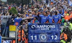 Chelsea fans greet the team after winning the Champions League