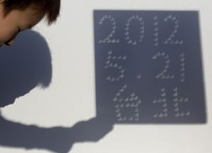 eclipse: The eclipse projected on to a wall to form the date and word 'Taipei'