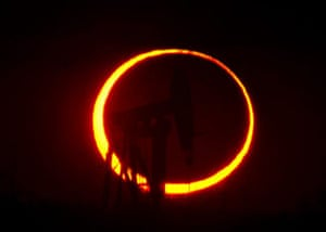 eclipse: The 'ring of fire' silhouettes an oil well in Texas