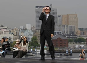 eclipse: Taking time out from business to watch the eclipse in Yokohama, Japan