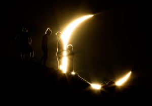 Picture desk live: Hikers watching the solar eclipse in Phoenix, Arizona