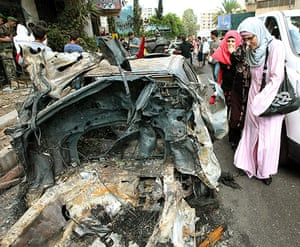 Picture desk live: A burnt out car is seen after violent clashes in Beirut, Lebanon
