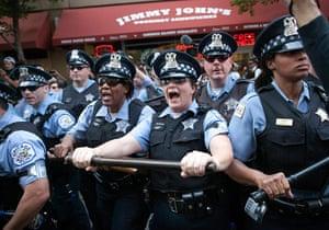 Picture desk live: Police prepare to charge at anti-NATO protesters in Chicago