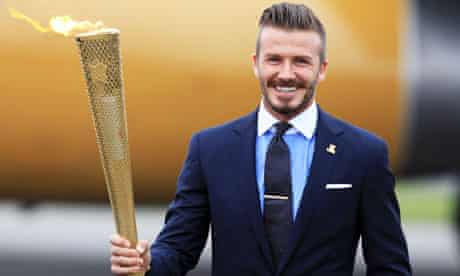 Olympic flame held by David Beckham